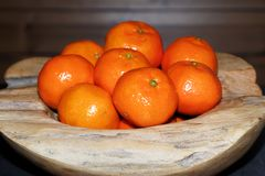 Pile of tangerines in a wooden bowl. Close-up of pile of tangerines in a wooden bowl. Torfhaus, Germany stock images
