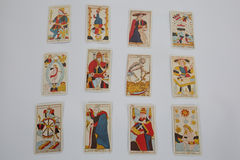A pile of tarot cards lie scattered and spread across a table Stock Photography