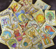 Pile of the tarot cards on the table. Background with the tarot cards, top view. The major arcana deck. Fortune telling seance or black magic ritual. Scary still royalty free stock image