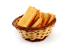 Pile of tea biscuits in a straw basket Stock Images