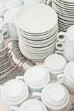 Pile tea tableware. Pile wihte tea tableware and spoons Stock Photography