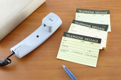 Pile of telephone message papers Royalty Free Stock Images
