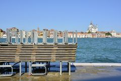 Raised Flood Walkways in Venice. A pile of temporary walkways which are used during the regular acqua alta / high water flooding in Venice. Photo taken from the Royalty Free Stock Photo