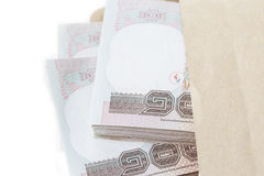 Pile of Thai banknotes in brown envelope on white background iso Royalty Free Stock Photography