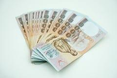 Pile of Thai money on white Royalty Free Stock Photo
