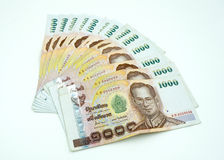 Pile of Thai money on white Royalty Free Stock Photos