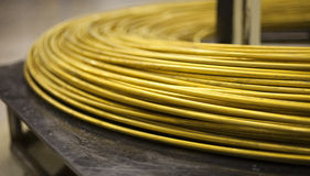 Pile of thick brass wire Royalty Free Stock Image
