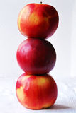 PILE: Three apples, one on others Royalty Free Stock Image