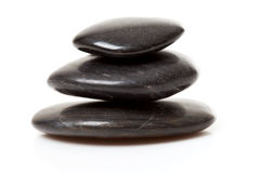 Pile of three black pebbles Royalty Free Stock Photo