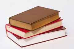 Pile of three books. Three books stacked up against a light background Stock Image