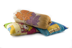 Pile of three colorful pillows Royalty Free Stock Photos