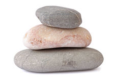 Pile of three stones. Over white Stock Photography