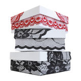 Pile of three stylish white gift boxes, decorated with exquisite black and red lace ribbon Stock Photography