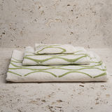 Pile of Three White Towels with Green Concave Lines Stock Photography