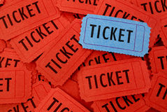 Pile of Tickets. Pile of many red and one blue tickets  for admission to an event Royalty Free Stock Images