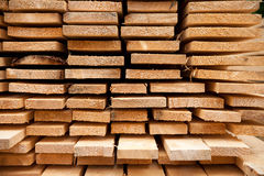 Pile of timber. Selection of timber material - planks freshly sawn Stock Photos