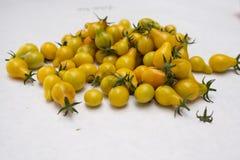 Pile of tiny yellow tomatoes stock photos