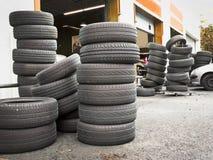 Pile of tires at car repair service station Stock Photos