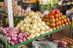 Pile of tomatoes and red and white onion in the market. General plan vegetable healthy ripe vegetarian nutrition fresh organic food yellow agriculture produce royalty free stock photo