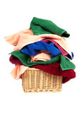 Pile of towels in a basket isolated on white background Royalty Free Stock Images