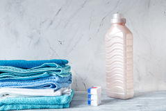 Pile of towels with detergent on laundry background mock up Stock Photography