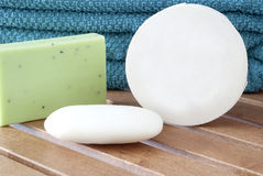 Pile of towels and Wellness Soap Stock Images