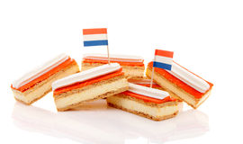 Pile of traditional Dutch pastry called tompouce with flags Stock Image