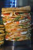 Pile of traditional italian food Piadina Romagnola with fresh tomato mozzarella and rocket salad stock image