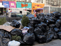 Pile of trash on street in New York City Stock Photography