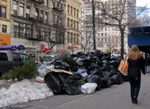 Pile of trash on street in New York City Stock Photos