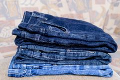 Pile trousers. Pile of blue jeans trousers royalty free stock photography