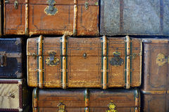 Pile of trunks. Abstract textured background created by a pile of old grungy cabin trunks with locks and reinforcing bars Royalty Free Stock Photos
