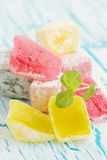 Pile Turkish delight. Delicious dessert Turkish delight on the cracked board royalty free stock images