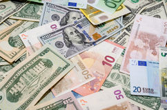Pile of two leading currencies - US Dollar versus Euro Stock Image