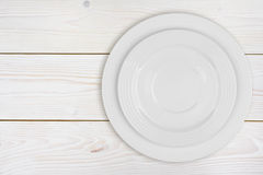 Pile of two white plates on bleached wooden plank background Royalty Free Stock Photography