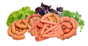 Pile of the uncooked different sausages and various greens Royalty Free Stock Photo