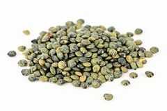 Pile of uncooked French lentils stock image