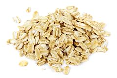 Pile of uncooked rolled oats stock image