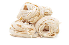 Pile of uncooked rolled traditional italian pasta Stock Photos