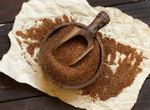 Pile of uncooked teff grain. In a bowl with a spoon close up stock photography