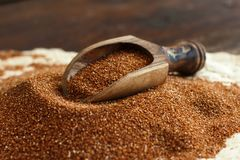 Pile of uncooked teff grain. With a spoon close up stock image