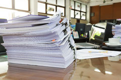 Pile of unfinished business documents on office desk, Stack of business paper Royalty Free Stock Photos
