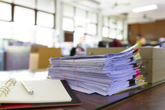 Pile of unfinished documents on office desk. Stack of business paper royalty free stock images