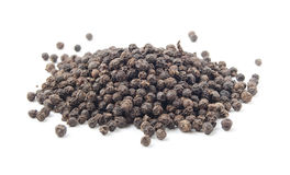 Pile of unground pepper. Isolated on the white background stock photo