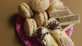 Pile of cookies. Junk food. Pile of unhealthy cookies in porcelain plates. Unhealthy food concept. Junk food stock video footage