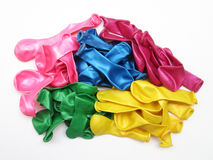 Pile of uninflated balloons from different colors Royalty Free Stock Image