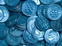 Pile of United States Coins. Bluetone Dimes Royalty Free Stock Images
