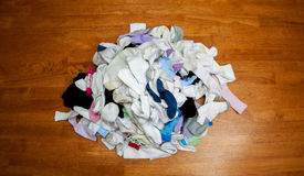 Pile of Unmatched Socks from Above. Pile of mismatched, clean socks. View from above on a dining room table Stock Image
