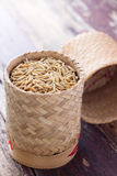 Pile of unmilled paddy grains in bamboo basket Royalty Free Stock Images