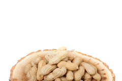 Pile of unshelled peanuts, isolated on white Stock Photos